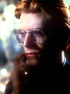 David Bowie wearing glasses