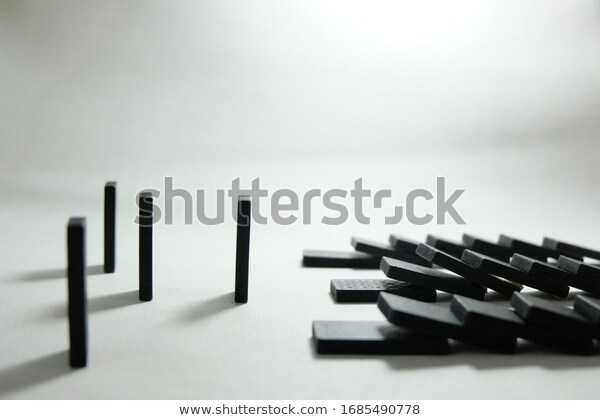 domino-pieces-on-white-background-600w-1685490778